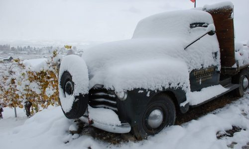 snow covered vintage truck at Little Straw Winery in West Kelowna BC